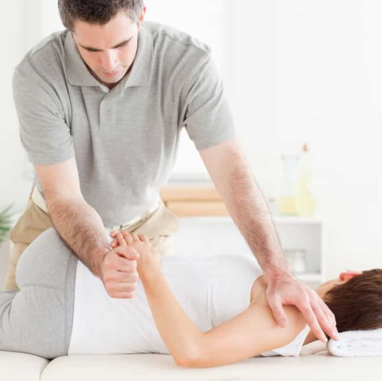 a chiropractor doing adjustments