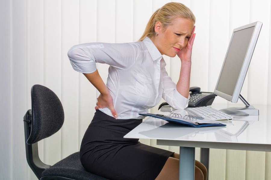 Headaches and Back Pain Due to Sitting at a Desk All Day