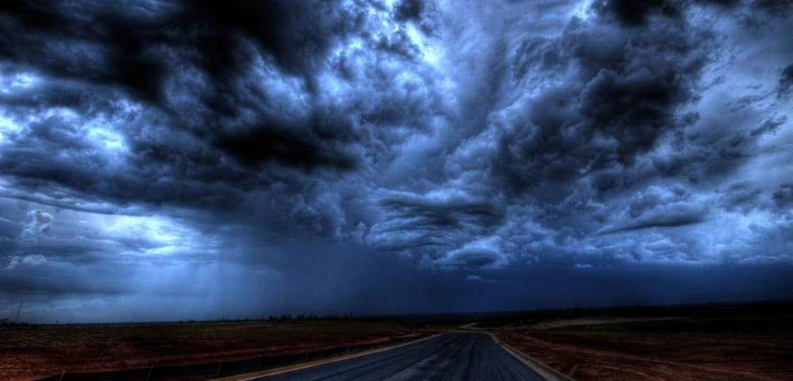 An image of the sky with huge, dark clouds